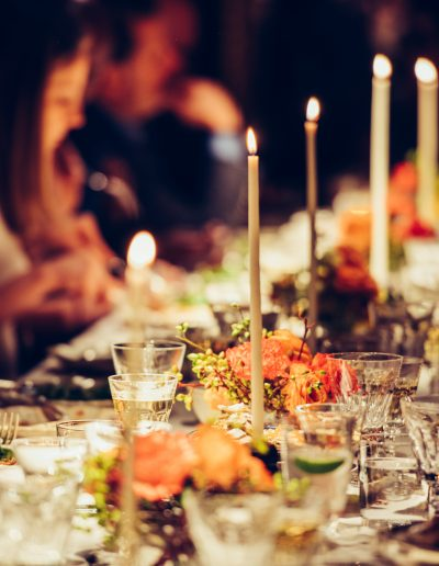 People dining at table with candles